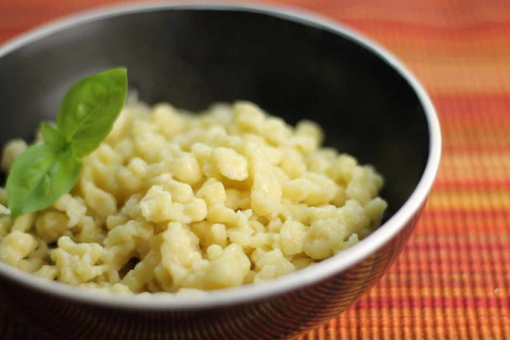 A close up of traditional German spaetzle in a black bowl