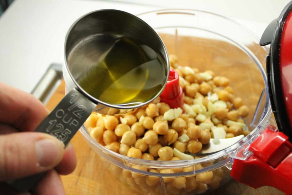 adding oil to the chickpeas
