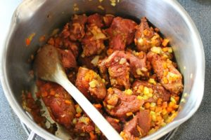 Diced marinated beef chuck and mixed vegetables being sauteed to make homemade German goulash.