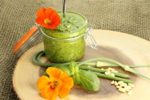 A deliciously simple Basil Pesto recipe using Garlic Scapes from the garden. A great way to preserve your basil harvest.