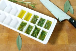 Store herbs in oil, by creating frozen oil pucks! Store these in the freezer and use them immediately in your cooking!