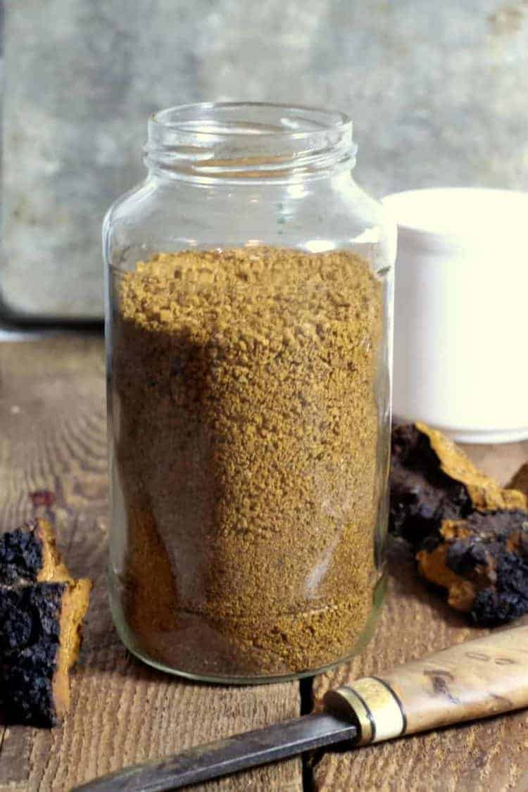 a glass jat filled with coarsly ground chaga mushroom