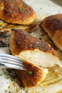 juicy and tender oven baked chicken breasts, vut open to check for doneness