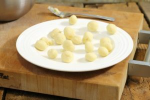 little balls of beurre manie on a white plate