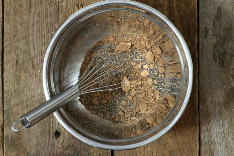 mixing dry chia seed, cocoa powder and salt in a bowl