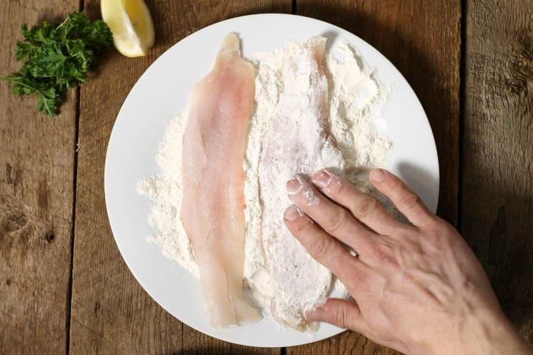 pan fried haddock starting to brown around the edges