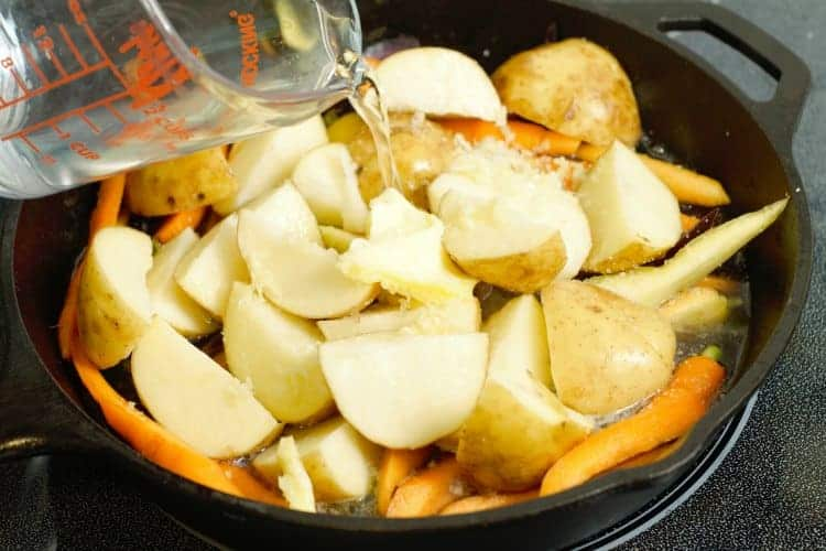 adding the root veg to a pan for hodge-podge