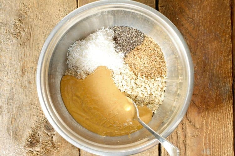 ingredients for peanut butter protein balls in a steel bowl