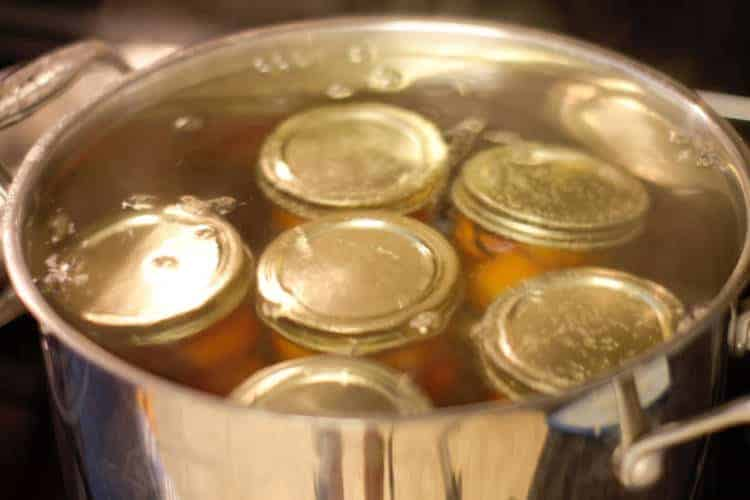 canning pickled cherry tomatoes in a hot water bath