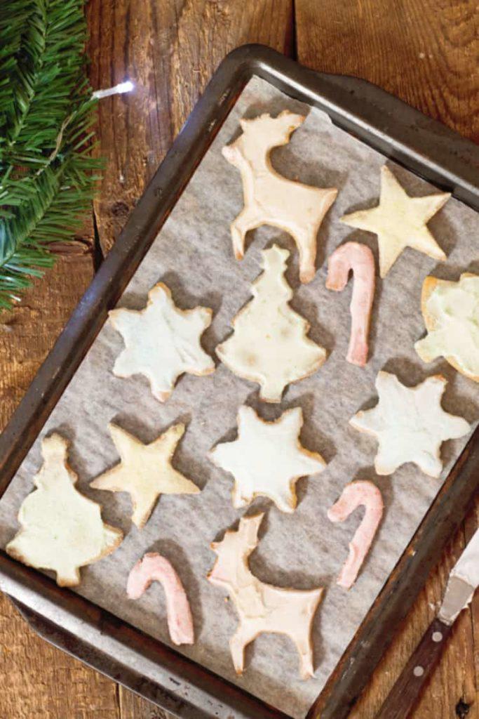 pastel colored sugar cookies on a sheet pan